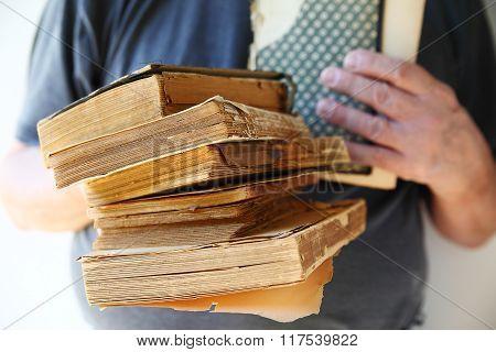Vintage books held by man