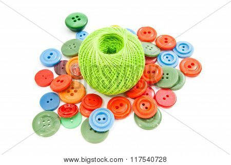 Green Ball Of Thread And Colorful Buttons