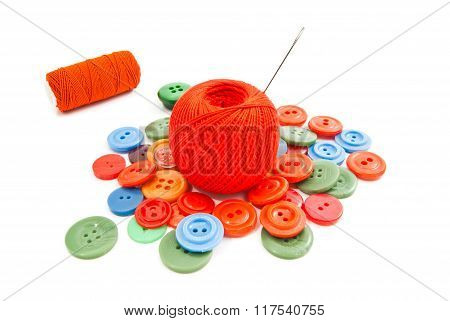 Needle, Buttons And Red Tangles Of Thread