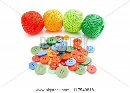 Colorful Buttons And Thread On White