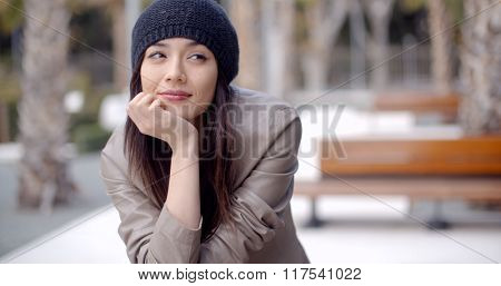 Thoughtful serious trendy young woman