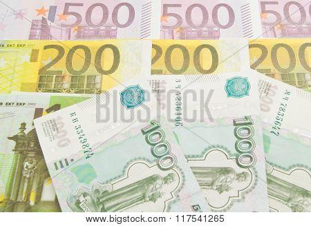 Three Russian Banknotes And Euro Banknotes