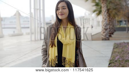 Stylish young woman enjoying a walk in town