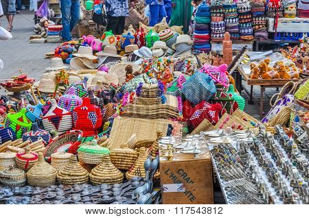 MARRAKESH, MOROCCO, APRIL 3, 2015:  Local sellers offer baskets and other souvenirs on street stands in souks