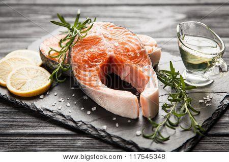 Fresh salmon on old wood