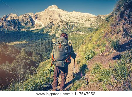 Man Traveler with backpack mountaineering Travel