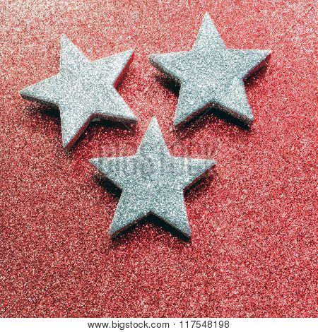Three Silver Stars On Red Illuminated Background