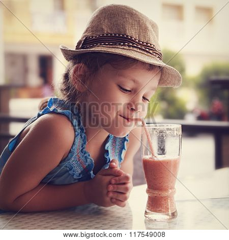 Cute Thinking Kid Girl Drinking Tasty Juice In Street Restaurant. Toned Closeup Portrait