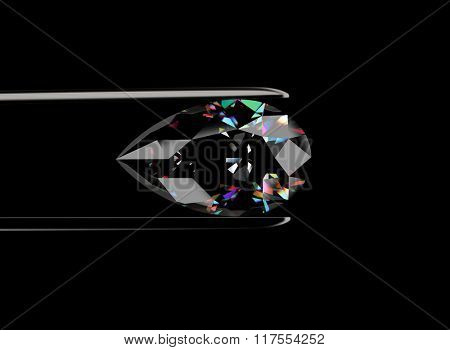 Gemstone in the tweezers on black bacground