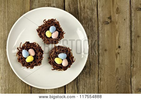 Plate of chocolate spring nests on rustic wood