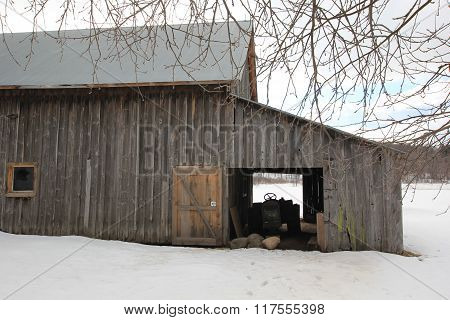 Barn with tractor in winter