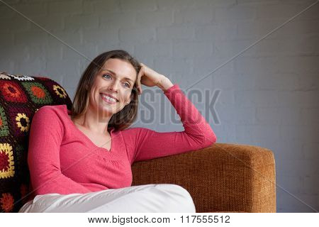Smiling Older Woman Relaxing On Couch