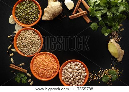 Bowls With Legumes And Indian Spices, Fresh And Dried On Black Background, Copy Space