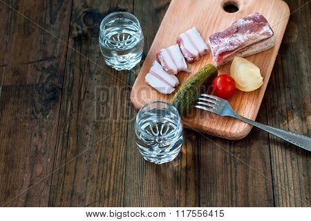 Cold Vodka In A Glass And Cucumber On A Wooden Table