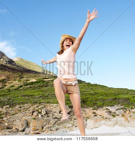 Happy Woman Jumping Outdoors