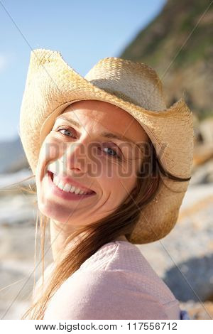 Smiling Woman With Hat At The Beach