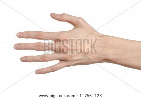 Medical Theme: For A Man's Hand Glued Medical Plaster First Aid Plaster Advertising On A White Backg