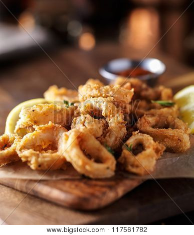 crispy fried calamari rings wih marinara dipping sauce and lemon