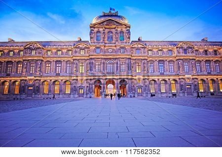 Paris, France, February 6, 2016: exterior of Louvre, the well-known residence of the French kings, nowadays - one of the largest museums of the fine arts in the world, Paris, France