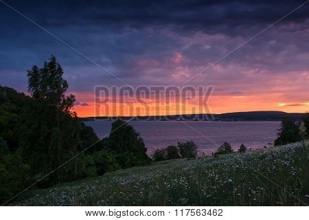 Beautiful Nature Landscape. Meadow On The Lake At Dusk