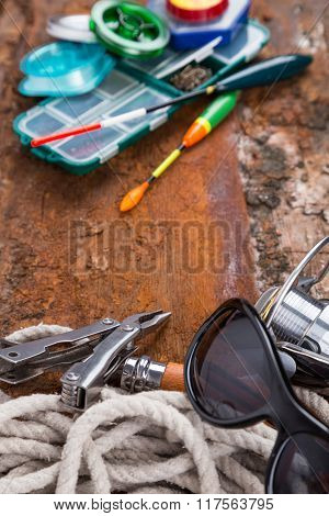 Fishing Tackles For Anglers On Wooden Background