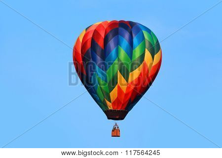 Colorful hot air balloon against blue background