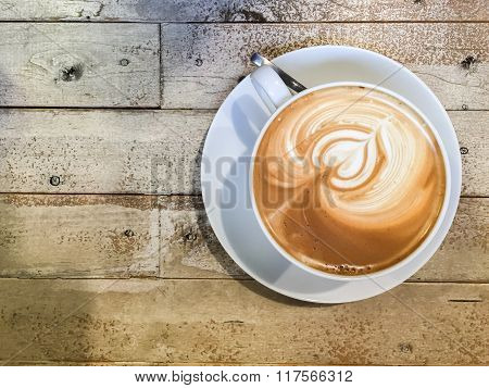 Latte Art Coffee On Wood Table Background