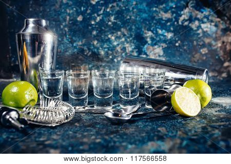 Alcoholic Shots Of Tequila Or Strong Drink In Small Glasses, With Lime Garnish Ready To Be Served