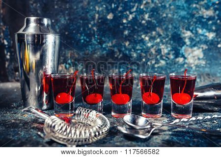 Red Alcoholic Drink In Shot Glasses, Aperitif And Digestive Drinks