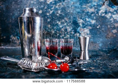 Red Cocktail With Sweet Flavour In Small Glasses. Alcoholic Drinks At Bar