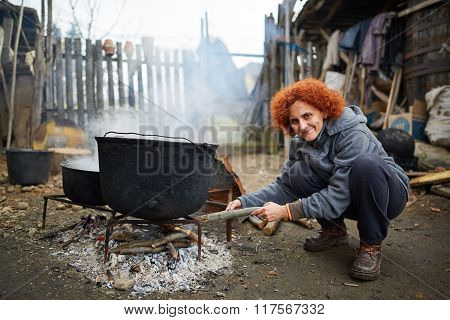 Rural Lady Boiling Water Outdoor
