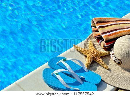 Woman Beach Hat, Bright Towel And Blue Flip-flops.