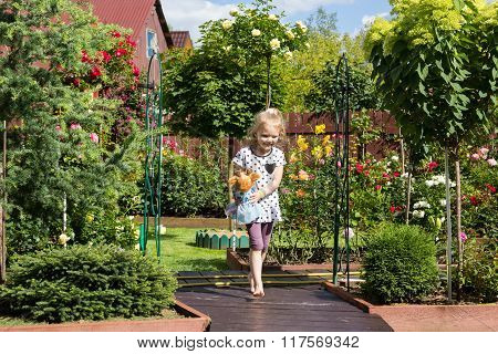 Girl Walking On Pathway In Beautiful Garden