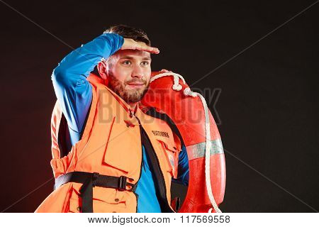 Lifeguard In Life Vest With Ring Buoy Lifebuoy.
