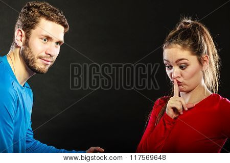 Man Husband talking to Woman Wife Asking For Silence.