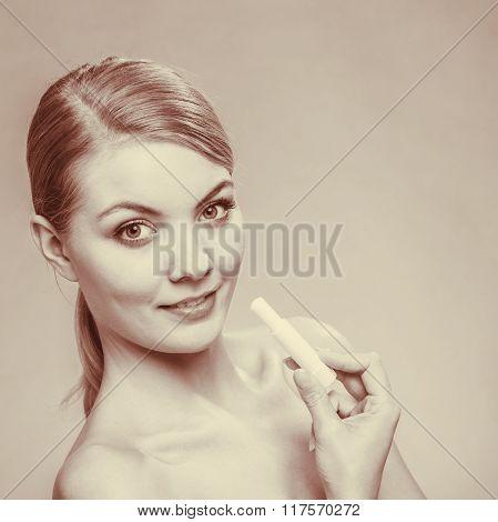 Young Woman Take Balm On Lips.
