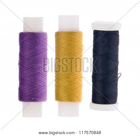 three spools of thread isolated on white background