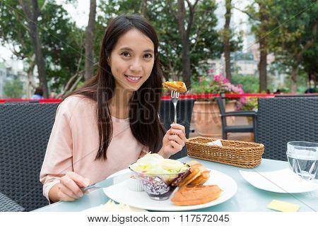 Woman eating Sweet homemade waffles