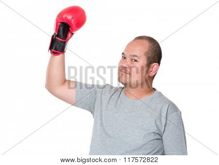 Man in boxing gloves celebrating his victory