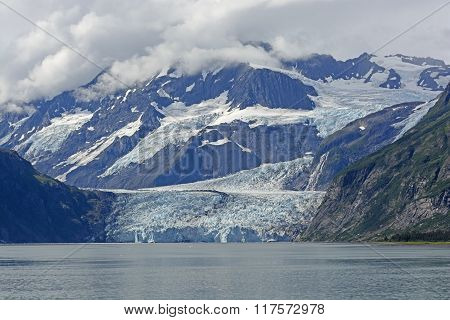 Dramatic Glacier Coming Out Of The Mountains