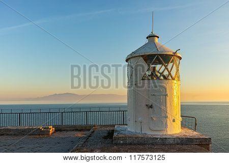 Amazing Sunset over Lighthouse in Kavala, Greece