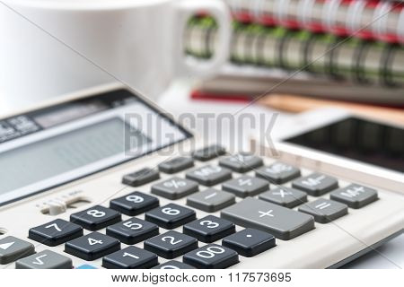 Close Up Of Business Documents On Office Table With Calculator And Eyeglasses