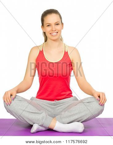 Sporty girl sit on the floor isolated