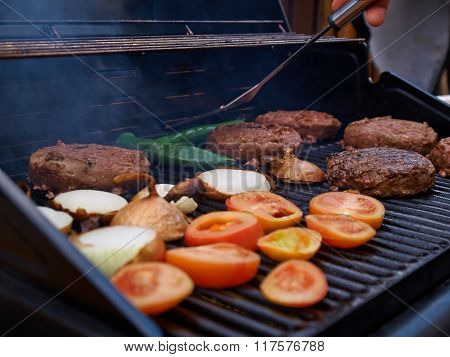 Grilling Homemade Hamburgers On A Grill