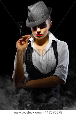 Young girl with cigar on black