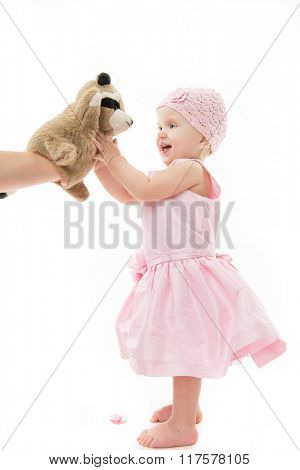 little child baby smiling  laughing playing with toy pink dress isolated on white studio shot