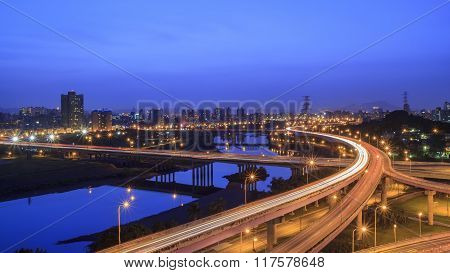 Aerial View Of Taipei Cityscape With River And Highway
