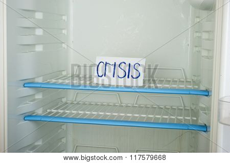 Label  the crisis in an empty refrigerator
