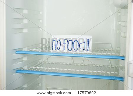 Label  no food  in an empty refrigerator