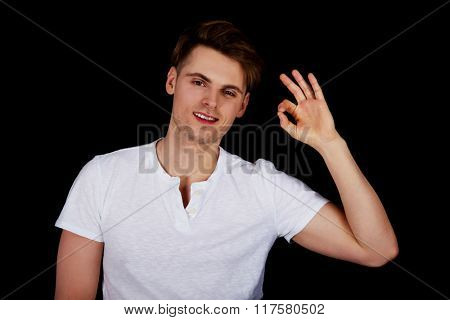 Happy man with perfect hand sign